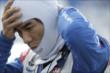 Takuma Sato adjusts his balaclava prior to his qualification run for the ABC Supply Wisconsin 250 at the Milwaukee Mile -- Photo by: Shawn Gritzmacher