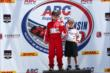 Young fans pose on the Milwaukee Mile podium -- Photo by: Chris Jones