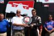 Will Power accepts the Verizon P1 Award trophy for winning the pole for the ABC Supply Wisconsin 250 at the Milwaukee Mile -- Photo by: Chris Jones