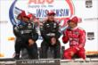 Juan Pablo Montoya, Will Power, and Tony Kanaan chat on Victory Lane after the ABC Supply Wisconsin 250 at the Milwaukee Mile -- Photo by: Chris Jones