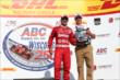 Tony Kanaan accepts his 3rd Place trophy in Victory Circle for the ABC Supply Wisconsin 250 at the Milwaukee Mile -- Photo by: Chris Jones