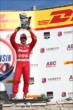 Tony Kanaan hoists his 3rd Place trophy in Victory Lane following the ABC Supply Wisconsin 250 at the Milwaukee Mile -- Photo by: Chris Jones