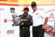 Juan Pablo Montoya receives his 2nd Place trophy in Victory Lane following the ABC Supply Wisconsin 250 at the Milwaukee Mile -- Photo by: Chris Jones