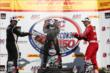 Juan Pablo Montoya and Tony Kanaan spray champagne towards Will Power in Victory Lane following the ABC Supply Wisconsin 250 at the Milwaukee Mile -- Photo by: Chris Jones