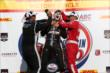 Juan Pablo Montoya and Tony Kanaan pour champagne down Will Power's firesuit in Victory Lane following the ABC Supply Wisconsin 250 at the Milwaukee Mile -- Photo by: Chris Jones
