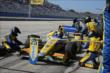 The Andretti Autosport team of Marco Andretti go to work during an early pit stop during the ABC Supply Wisconsin 250 at the Milwaukee Mile -- Photo by: Chris Jones