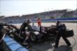 The Team Penske crew go to work on Will Power's machine at the Milwaukee Mile -- Photo by: Chris Jones