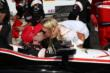 Will Power gets a victory kiss from his wife, Liz, in Victory Lane after winning the ABC Supply Wisconsin 250 at the Milwaukee Mile -- Photo by: Chris Jones
