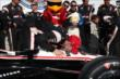 Will Power gives his machine a celebratory kiss in Victory Lane after winning the ABC Supply Wisconsin 250 at the Milwaukee Mile -- Photo by: Chris Jones