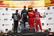 The podium of Will Power, Juan Pablo Montoya, and Tony Kanaan pose with the Firestone Firehawk in Victory Circle at the Milwaukee Mile -- Photo by: Chris Jones