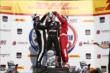 Juan Pablo Montoya and Tony Kanaan pour champagne down Will Power's firesuit in Victory Circle following the ABC Supply Wisconsin 250 at the Milwaukee Mile -- Photo by: Chris Jones