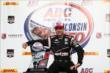 Will Power sits in Victory Circle with his Winner's Trophy after winning the ABC Supply Wisconsin 250 at the Milwaukee Mile -- Photo by: Chris Jones