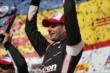 Will Power raises his trophy after winning the ABC Supply Wisconsin 250 at the Milwaukee Mile -- Photo by: Shawn Gritzmacher