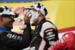 Teammate Juan Pablo Montoya smashes a cream puff into Will Power's face in Victory Circle at the Milwaukee Mile -- Photo by: Shawn Gritzmacher