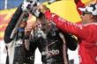 Will Power receives a champagne shower in Victory Circle at the Milwaukee Mile from Juan Pablo Montoya and Tony Kanaan -- Photo by: Shawn Gritzmacher