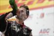 Will Power swigs champagne in Victory Circle after winning the ABC Supply Wisconsin 250 at the Milwaukee Mile -- Photo by: Shawn Gritzmacher