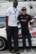 Dominique Wilkins poses with Honda pace car driver Martin Plowman after taking a hot lap ride around the Milwaukee Mile -- Photo by: Shawn Gritzmacher