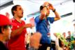Juan Pablo Montoya (Colombia) and Helio Castroneves (Brazil) react during the World Cup Watch Party at Pocono Raceway -- Photo by: Bret Kelley