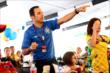 Helio Castroneves (Brazil) watches on during the FIFA World Cup 2014 match between Brazil and Colombia at Pocono Raceway -- Photo by: Bret Kelley