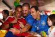 Juan Pablo Montoya (Colombia) poses with Tony Kanaan and Helio Castroneves (Brazil) during the World Cup Watch Party at Pocono Raceway -- Photo by: Chris Jones