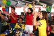 Sebastian Saavedra, Carlos Huertas, Connie Montoya, and Adriana Henao celebrate a goal for Colombia during the World Cup Watch Party at Pocono Raceway -- Photo by: Chris Jones