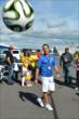 Helio Castroneves (Brazil) kicks around a soccer ball during halftime of the FIFA World Cup 2014 match between Brazil and Colombia at Pocono Raceway -- Photo by: Chris Owens