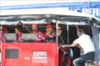 Tony Kanaan and his Target Chip Ganassi team chat in the pit stand at Pocono Raceway -- Photo by: Bret Kelley