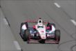 Helio Castroneves streaks down the frontstretch during practice at Pocono Raceway -- Photo by: Bret Kelley