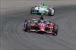 Sebastien Bourdais leads Carlos Munos in Turn 3 during practice at Pocono Raceway -- Photo by: Bret Kelley