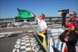 The green flag flies for a qualification attempt at Pocono Raceway -- Photo by: Bret Kelley