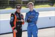 Simon Pagenaud and Josef Newgarden on pit lane prior to qualifications for the Pocono INDYCAR 500 -- Photo by: Chris Jones
