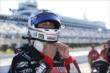 Graham Rahal straps his helmet on prior to qualifications for the Pocono INDYCAR 500 at Pocono Raceway -- Photo by: Chris Jones