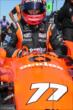 Simon Pagenaud slides into his machine prior to practice at Pocono Raceway -- Photo by: Chris Jones