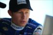Ryan Briscoe reviews telemetry data with his team after practice for the 2014 Pocono INDYCAR 500 -- Photo by: Chris Jones
