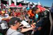 Helio Castroneves signs some autographs in the INDYCAR Fan Village at Pocono Raceway -- Photo by: Chris Jones