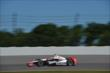 Helio Castroneves enters Turn 3 during practice for the  Pocono INDYCAR 500 at Pocono Raceway -- Photo by: Chris Owens