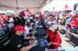 Fans line up for autographs in the INDYCAR Fan Village at Pocono Raceway -- Photo by: Bret Kelley