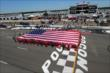 The American Flag is displayed for the National Anthem during pre-race festivities for the Pocono INDYCAR 500 at Pocono Raceway -- Photo by: Bret Kelley