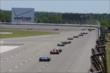 The field streams into Turn 1 during the Pocono INDYCAR 500 -- Photo by: Bret Kelley