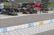 Pit lane gets active during the first round of pit stops for the Pocono INDYCAR 500 -- Photo by: Bret Kelley