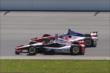 Helio Castroneves and Takuma Sato go side-by-side during the Pocono INDYCAR 500 at Pocono Raceway -- Photo by: Chris Jones