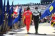 Teammates Sebastian Saavedra and Sebastien Bourdais walk out during pre-race activities for the Pocono INDYCAR 500 -- Photo by: Chris Jones