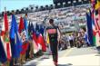 Graham Rahal walks out to the grid during pre-race activities for the Pocono INDYCAR 500 -- Photo by: Chris Jones
