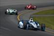 Juan Pablo Montoya leads Carlos Munoz and Tony Kanaan. -- Photo by: Chris Owens