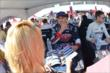 Graham Rahal signs autographs in the INDYCAR Fan Village -- Photo by: Chris Owens