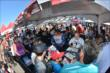 Fans line up for autographs in the INDYCAR Fan Village at Pocono Raceway -- Photo by: Chris Owens