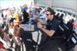 Simon Pagenaud signs an autograph for a young fan in the INDYCAR Fan Village at Pocono Raceway -- Photo by: Chris Owens
