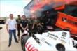 Mikhail Aleshin and Simon Pagenaud pose with members of the Ft. Worth SWAT team at Texas Motor Speedway -- Photo by: Chris Jones