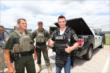 Mikhail Aleshin tries on body armor from the Ft. Worth SWAT team at Texas Motor Speedway -- Photo by: Chris Jones