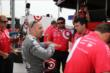 Tony Kanaan talks with his team during practice for the Firestone 600 at Texas Motor Speedway -- Photo by: Chris Jones
